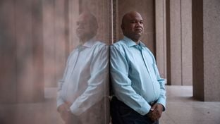Leonard Abbott became trapped in a cycle of debt after taking out a $500 loan from a payday lender. Proposed federal regulations might have prevented him from taking out successive loans. Abbott works at the Texas Capitol as a security guard.