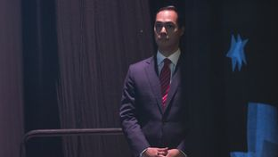 HUD SECRETARY waits behind the stage at the Texas Democratic Convention on June 17, 2016