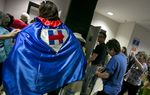 A Hillary Clinton Supporter sports a cape at the state Democratic convention in San Antonio on June 17, 2016.