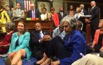 A photo shot and tweeted from the floor of the House by U.S. Rep. Katherine Clark, D-Massachusetts, shows Democratic House members staging a sit-in over gun legislation on Capitol Hill in Washington, D.C. on June 22, 2016.