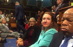"""A photo shot and tweeted from the floor of the House by U.S. House Rep. David Cicilline shows Democratic members of the U.S. House of Representatives, including Rep. John Lewis (R) staging a sit-in on the House floor """"to demand action on common sense gun legislation"""" on Capitol Hill in Washington, D.C. on June 22, 2016."""