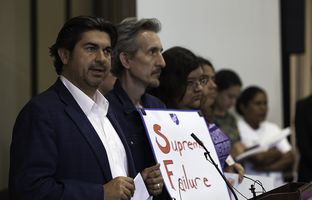 Eddie Rodriguez (left), State Rep. from District 51, spoke at the press conference held by University Leadership Initiative, an undocumented youth-led organization, after the Supreme Court's decision to block President Obama's DAPA program on Thursday.