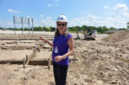 Pam Seipp, interim superintendent of Runge schools, looks over ongoing construction of a new football stadium. In May 2014, before oil prices tanked, local voters approved a $22 million bond to build — and renovate — new campuses, sports facilities and a bus barn. The district has since sold $20 million worth of bonds, but is now looking at restructuring the terms because it can't afford payments.