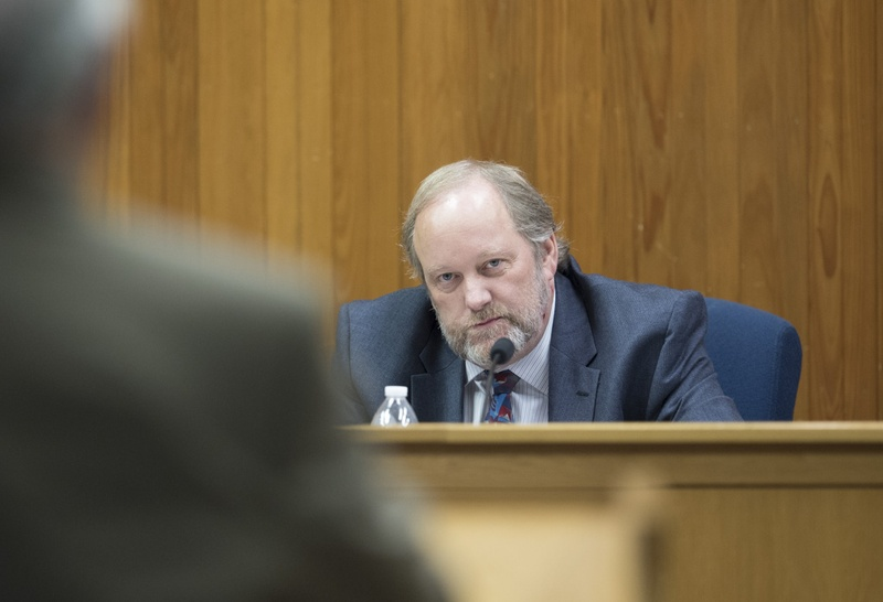 Texas Commissioner of Insurance David Mattax listens to advocates and insurance industry representatives during a public hearing on arbitration clauses for homeowner's insurance on July 6, 2016.