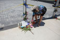 Clara Brown Trimble, 63, put flowers next to a small memorial to police officers killed by sniper fire the night before in downtown Dallas following a peaceful Black Lives Matter Protest.