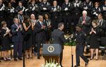 Dallas Mayor Mike Rawlings shakes Chief of Police David Brown's hand as former President Bush, President Obama, their wives, U.S. Sens. Cornyn and Cruz and others applaud on July 12, 2016.