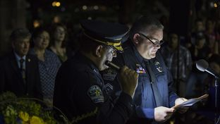 Austin Police Association President Ken Casaday reads a speech during an evening vigil to honor five slain Dallas police officers at the state Capitol on July 14, 2016.