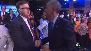 "Texas Lt. Gov. Dan Patrick and President Barack Obama shake hands after the ""People Town Hall: A National Conversation,"" an event hosted by ABC News and ESPN."