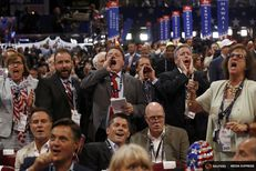 Republican National Convention delegates in Cleveland yell and scream as the Republican National Committee Rules Committee announces it will not hold a recorded vote that anti-Trump forces had wanted on July 18, 2016.
