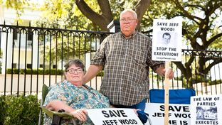 Mitzie and Danny Wood, parents of Jeff Wood, at a rally last month at the Governor's mansion. Their son, Jeff, awaits his execution, sent to death row under the controversial law of parties statute.
