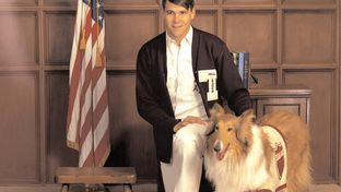Rick Perry with Reveille, the Texas A&M mascot. This image is included in Perry's collection in the Texas Digital Archive.