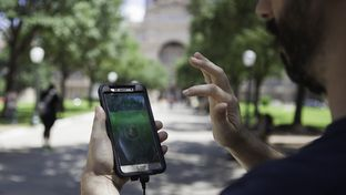 "James Ratcliff, 39, plays ""Pokémon Go"" outside the Texas Capitol on Thursday. ""We're trying to figure out if there are more people here playing than visiting the Capitol,"" he said. ""We think there is."""