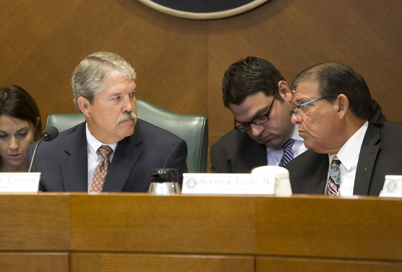 Sen. Larry Taylor R-Friendswood and Sen. Eddie Lucio D-Brownsville during an Aug 3, 2016 Senate Education Committee hearing