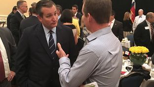 U.S. Sen. Ted Cruz speaks with a constituent at a chamber of commerce breakfast in San Antonio on July 10, 2016.
