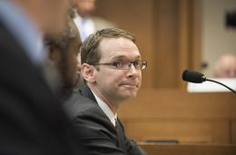 Texas Education Agency Commissioner Mike Morath testifies on school board issues before the Senate Committee on Education August 16, 2016.