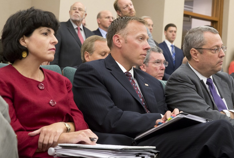 Texas Railroad Commissioners Christi Craddick, Ryan Sitton and David Porter wait for their turn to testify before the Sunset Advisory Commission on August 22, 2016
