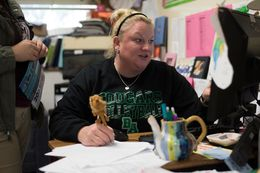 Coach Krystal Morrow works at her desk at Bryan Adams High School in Dallas, Texas.