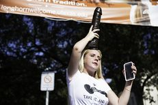 UT-Austin junior Rosie Zander displays a dildo as part of the Cocks Not Glocks protest of Texas' campus carry law on Aug. 23, 2016.