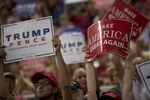 Supporters of Republican presidential nominee Donald Trump hold up signs during a rally in Austin on Aug. 23, 2016.
