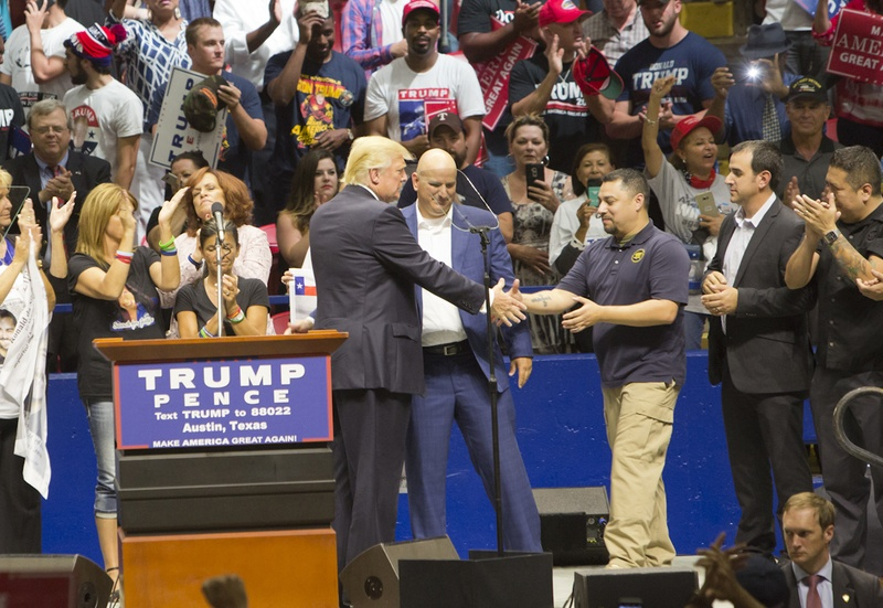 Republican Presidential nominee, Donald Trump greets a group of border patrol agents on stage during an August 23, 2016 rally. Trump announced the border patrol endorsement during the rally