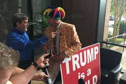 Wearing his trademark jester hat, Rob Morrow spoke to reporters on Aug. 24, 2016, in Austin about no longer serving as Travis County GOP chairman. As he spoke, county party steering committee member Joe Pojman asked him to leave.