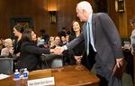 U.S. Sen. John Cornyn, R-Texas, greets Irma Carrillo Ramirez (l.), nominee for the United States District Court for the Northern District of Texas, and Karen Gren Scholer, nominee for the United States District Court for the Eastern District of Texas, before chairing the U.S. Senate Judiciary Committee hearing in which they and three others will be confirmed, on Capitol Hill in Washington, D.C. on September 7, 2016. The candidates were nominated earlier this year after being recommended by Sens. Cornyn and Ted Cruz to President Obama.
