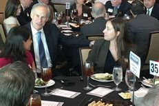 Gov. Greg Abbott mingles with the crowd before speaking at a luncheon Thursday for the Waco Chamber of Commerce. In his remarks, Abbott expressed caution about high-speed rail in Texas.
