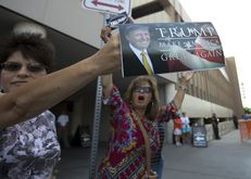 Trump supporters outside the Hyatt Hotel in San Antonio where Republican Presidential nominee Donald Trump was expected to attend a fundraiser on October 11, 2016
