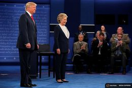 U.S. Republican presidential nominee Donald Trump and U.S. Democratic presidential nominee Hillary Clinton take the stage at their presidential town hall debate at Washington University in St. Louis on Oct. 9, 2016.