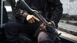 A Policia Nacional Civil patrol in the 22 de Abril neighborhood of Soyapango, just outside of San Salvador, El Salvador. The neighborhood is known to be controlled by the Mara Salvatrucha gang.