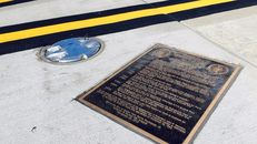 The bronze marker on a taxiway at Love Field, inaccessible to the public, which forever marks the spot where LBJ took the oath of office on November 22, 1963.