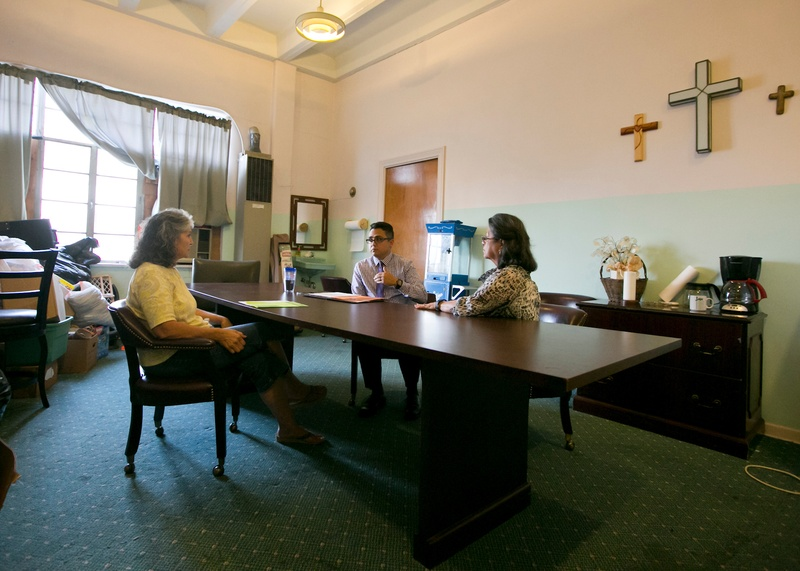 Grandmothers Mercedes Bristol (L) and Delia Martinez meet with with Ray Sauceda, district director for state Rep. Rick Galindo, R-San Antonio at the Divine Grace United Methodist Church in San Antonio on Oct. 19, 2016.