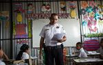 "Henry Vladimir Melgar Amaya, 32, an officer in the Policia Nacional Civil Departamento de Prevención, the prevention unit of the national police, leads a lesson for a room of 20 students at the Centro Escolar ""Caserio El Pital C/Entre Rios"" elementary school in Lourdes, El Salvador. The school and its students are the recipients of US Embassy-funded gang prevention educational programming."