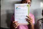"""A student presents her answers to gang related questions in an El Salvador elementary school workbook. """"What have you heard recently about gangs and violence?"""" the question asks. """"That there are a lot of murders"""" reads the student's response."""