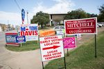 Signs line the property of the Oak Cliff Sub-Courthouse in Dallas, Texas, on the first day of early voting on Monday, Oct. 24, 2016.