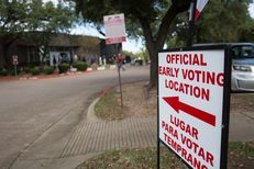 Voters line up outside the Oak Cliff Sub-Courthouse in Dallas, Texas, for the first day of early voting on Monday, Oct. 24, 2016.