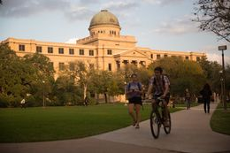 Students walking around the Texas A&M University campus in College Station, TX.