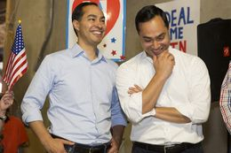 HUD Secretary Julián Castro, left, and his twin brother, U.S. Rep. Joaquin Castro, D-San Antonio, attend a Day of Action on Oct. 29, 2016, at the Travis County Democratic Party headquarters in Austin.