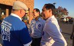HUD Secretary Julián (l.) and twin brother, U.S. Rep. Joaquin Castro, D-San Antonio, campaign for Hillary Clinton at a Columbus, Ohio polling location on November 6, 2016.