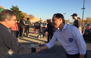 U.S. Rep. Joaquin Castro, D-San Antonio, encourages voters in line to support Hillary Clinton in Columbus, Ohio on November 6, 2016.