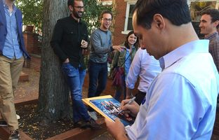 U.S. Secretary of Housing and Urban Development Julián Castro signs a copy of Texas Monthly while campaigning for Hillary Clinton in Columbus, Ohio on November 6, 2016.