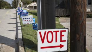 Campaign signs lined the edge of the Farmersville City Hall property on the first day of early voting on Oct. 24, 2016.
