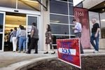 As the doors open at 7 a.m. on Election Day 2016, people stream into the George Washington Carver Library in Austin, Texas to cast their vote.
