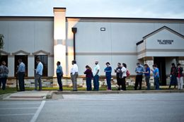 People wait to vote before polls open on election day in Round Rock, Nov 8, 2016.