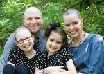 Georgia Moore, front left, was diagnosed with leukemia, and had to undergo chemotherapy that affected her immune system. She had to stay home from school because her parents worried unvaccinated kids might make her sick.
