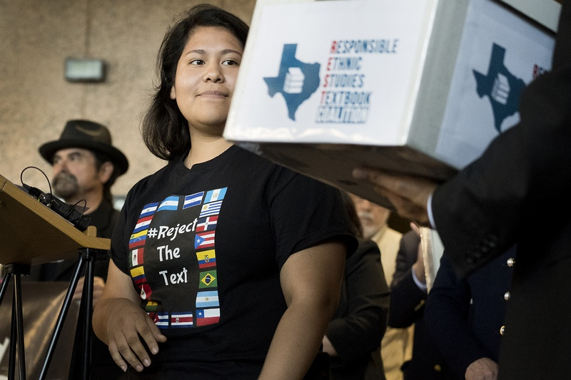 Carolina Hernandez, a student in the Houston ISD, spoke during a news conference at the Texas Education Agency on Nov. 15, 2016, about a proposed Mexican-American studies textbook that educators and activists have criticized. As Hernandez spoke, she glanced at a box holding 15,000 petitions against the textbook.