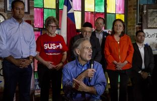 Gov. Greg Abbott addresses supporters at a get-out-the-vote rally as U.S. Rep. Will Hurd, R-San Antonio listens on November 7, 2016.