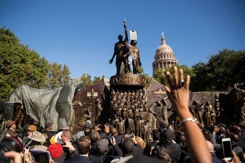 Hundreds of guests gathered on the south lawn of the Texas Capitol to mark the unveiling of the Texas African American History Memorial, which depicts the more than four centuries of contributions of blacks in the state's history.