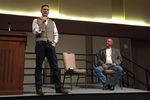 White supremacist Richard Spencer speaks at Texas A&M University in College Station while Preston Wiginton, who privately arranged the event, listens, on December 6, 2016.