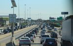 Cars back up during afternoon weekday traffic on southbound Interstate 45 in Houston north of downtown.
